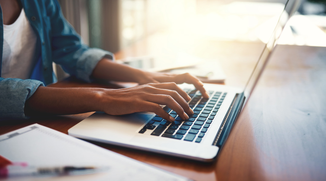 Person typing on keyboard - Trinity Health - Hand and Wrist Surgery