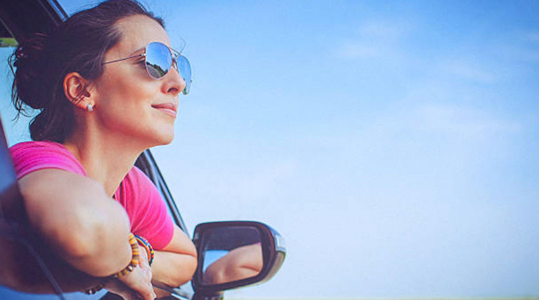 Woman leaning out of car   Allerygy and Immunology   Trinity Health